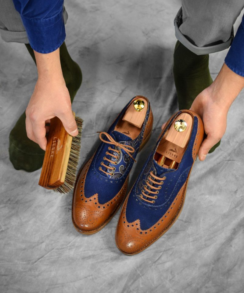 unique pair of oxford shoes in blue suede and cognac brown leather